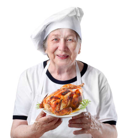 Senior woman with roasted chicken photo