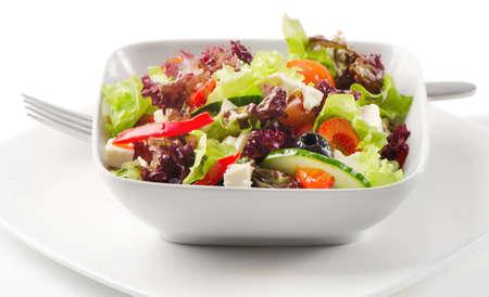 Fresh greek salad isolated on white photo