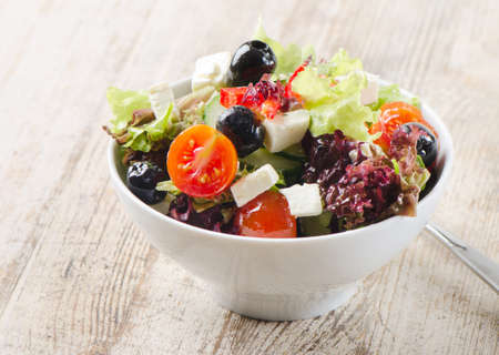greek salad on a wooden table photo