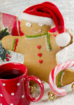 Homemade gingerbread man and tea photo