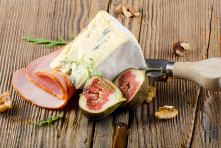 cheeseboard: Cheese  and ham on wooden table Stock Photo