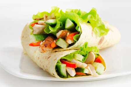 tortilla wraps with chicken  and fresh vegetables photo