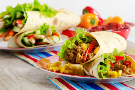 burrito: tortilla wraps with meat and fresh vegetables
