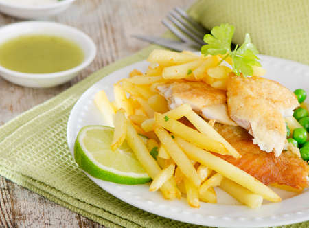 British food - fish and chips on a wooden table photo