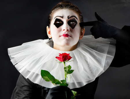pierrot: woman mime with red rose