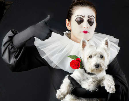 woman mime with little dog and red flower photo