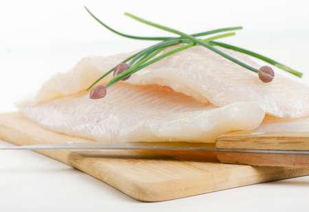tilapiini: Fillet of fresh fish with herbs  Selective focus
