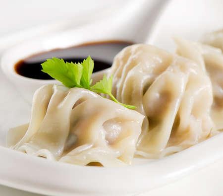 Dumplings with soy sauce.Selective focus photo