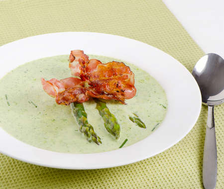 Creamy soup with asparagus   Selective focus photo
