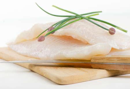 tilapiini: Fillet of fresh fish with herbs. Selective focus Stock Photo