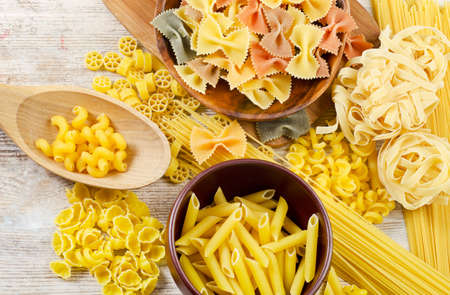 assortment of pasta on a wooden table photo