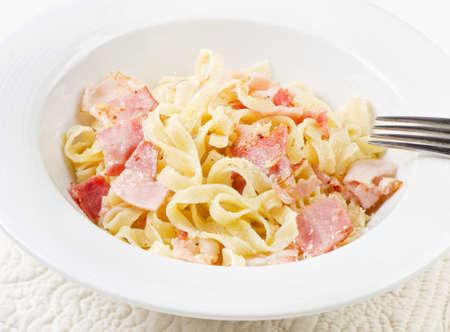 Pasta Carbonara on a white plate photo