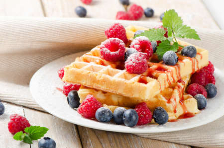 Waffles with berries. Selective focus