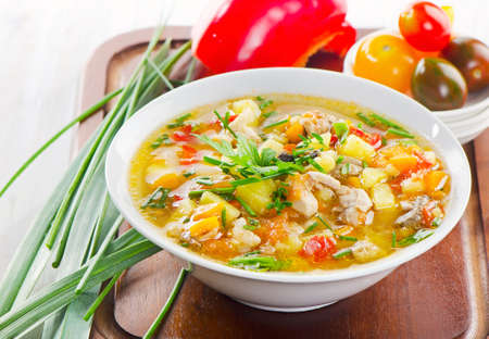 Bowl of vegetable Soup with chicken. Selective focus Stock Photo