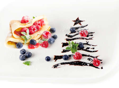 sweet christmas tree with crepes,berries and mint isolated on white Stock Photo