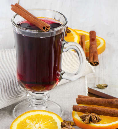 mulled wine: mulled wine with spices  on  wooden table Stock Photo