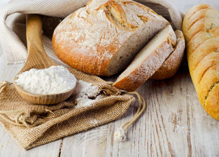 Bread on wooden table. Selective focus Stock Photo