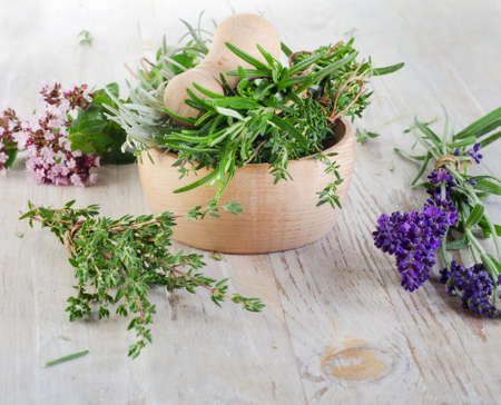 Herbs on a wooden table . Selective focus photo