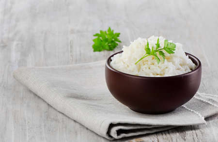White rice on a wooden table. Selective focus Stock Photo