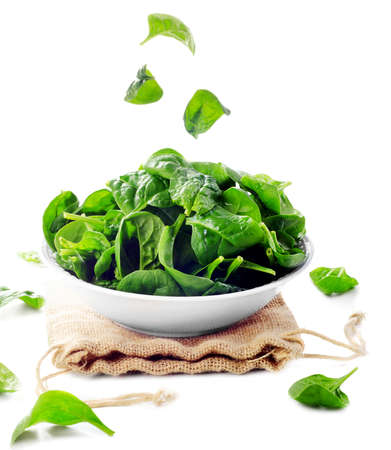 Fresh green spinach leaves isolated on white. Selective focus Stock Photo