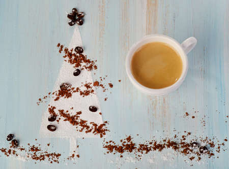 Christmas coffee and   sweet christmas tree  on wooden background photo