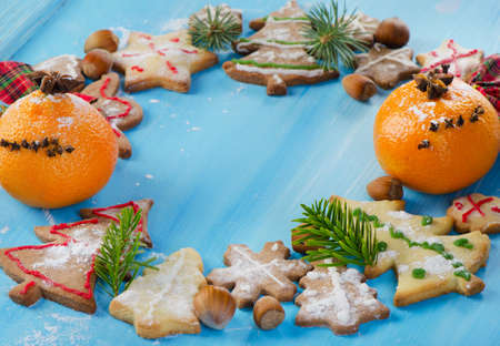 Homemade christmas cookies on wooden table. Selective focus photo