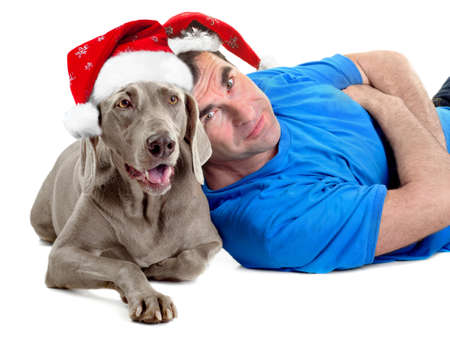 Happy man with his Santa dog isolated on white background photo