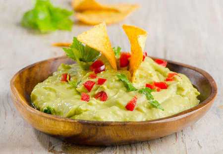 Guacamole on wooden table