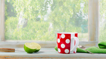 Cup of tea with lime photo