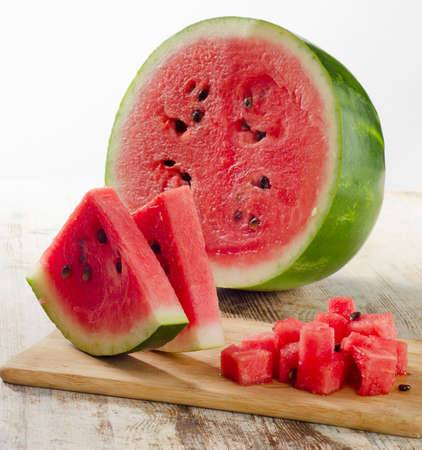 slices of watermelon on wooden table photo