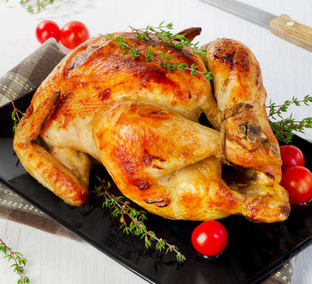Roasted chicken . Selective focus photo