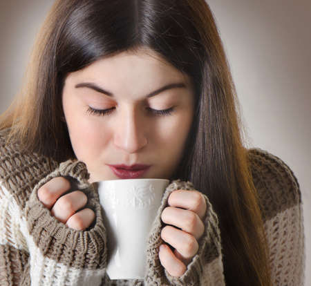 Young woman drinking  hot tea photo