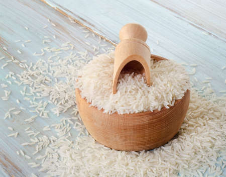 Rice  on a wooden table. Selective focus photo