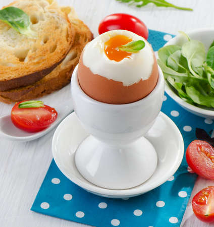 Soft boiled egg with toast and herb - healthy breakfast. Selective focus Stock Photo