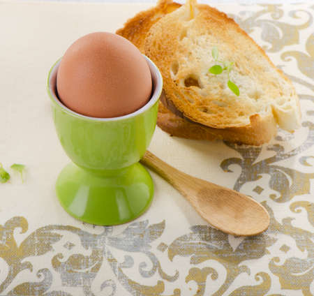eggcup: Boiled brown egg in eggcup. Selective focus Stock Photo