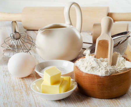baking ingredients on a wooden table . Selective focus photo
