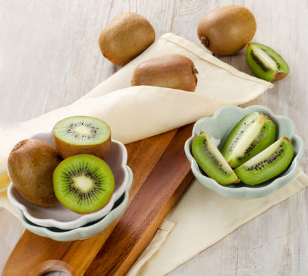 Fresh kiwi on a wooden table. Selective focus photo