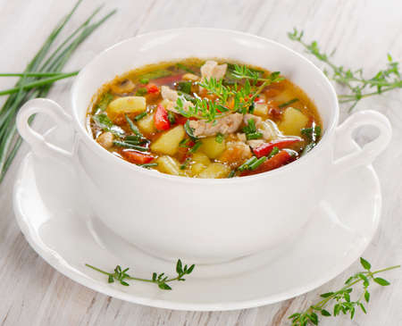 vegetable soup: Soup with vegetables and chicken . Selective focus