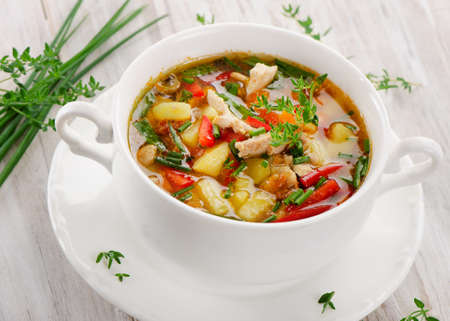 minestrone: Soup with vegetables and chicken . Selective focus