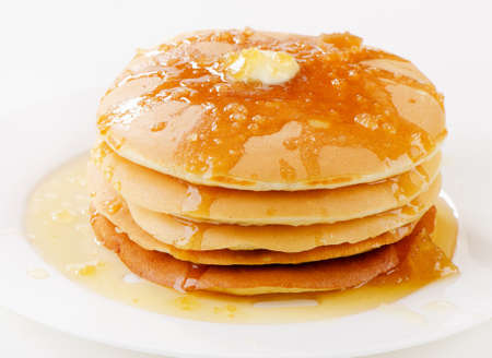 flapjacks: pancakes topped with honey . Selective focus Stock Photo