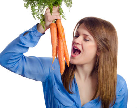 Young smiling woman holds bunch of carrots photo