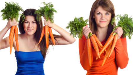 Young smiling women with  bunch of carrots isolated on white photo