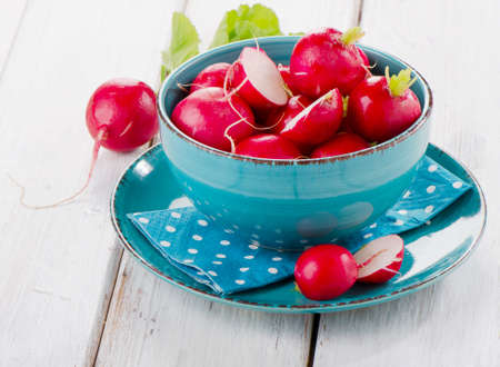 fresh radish in a blue plate. Selective focus