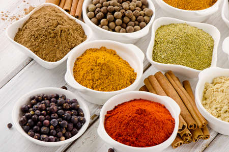Assortment of powder spices in bowls. Selective focus photo