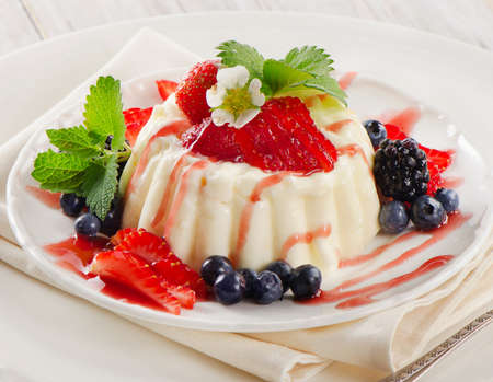 Delicious creamy dessert with fresh berries  Selective focus photo