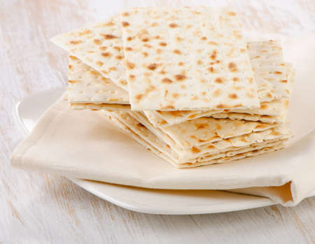 matzo: matzoh - jewish passover bread on a wooden table. Selective focus