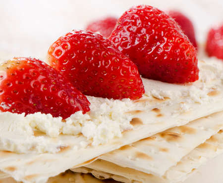 matzos: matzoh With cheese and berries  on a wooden table. Selective focus Stock Photo