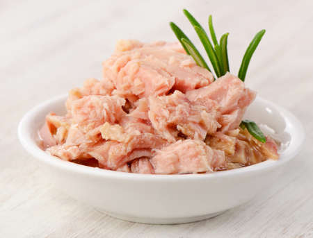 Canned tuna fish in white bowl . Selective focus photo