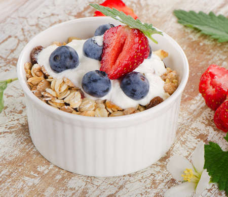 Muesli and yogurt with fresh berries. Selective focus photo