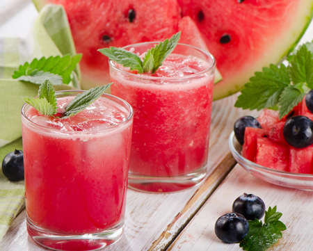 Watermelon smoothie on a wooden table. Selective focus Stock Photo